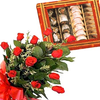 Half Kg. assorted sweets and a bouquet of 24 mixed color roses.