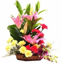 Purple Orchids Yellow Carnations Pink Lilies in Basket