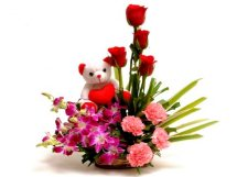Teddy in basket of 6 red rose 6 purple orchid 6 pink carnation