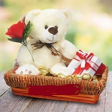 Teddy bear (6 inches ) with 1 red roses 1 Silk in same basket
