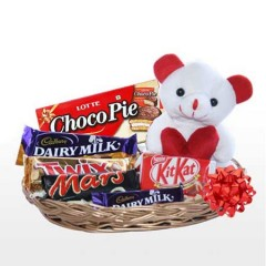 Teddy in basket of mix chocolate