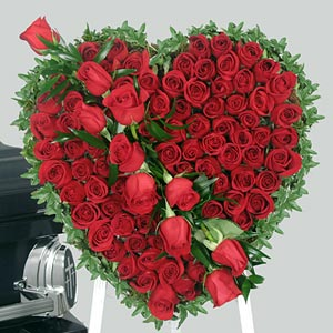 Heart shaped arrangement of 3 dozen red roses.