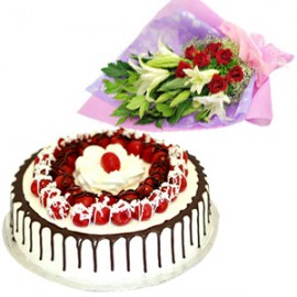 1/2 kg Black Forest Cake with White Lilies red roses in a bouquet