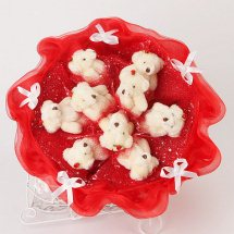 Bouquet of 9 Teddy bears with red wrapping