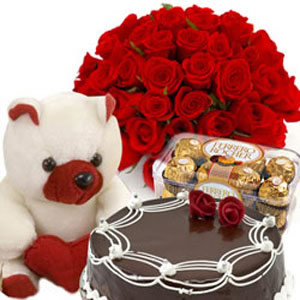 12 red roses+Teddy+1/2 Kg Chocolate Cake+16 pieces Ferrero Rocher chocolate box
