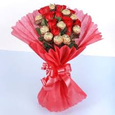 16 Pieces of Ferrero rocher chocolates with 6 red roses in a bouquet