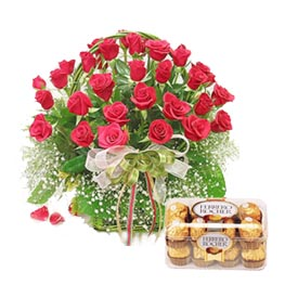 Box of 16 pieces Fererro Rocher chocolates.+24 Red Roses basket