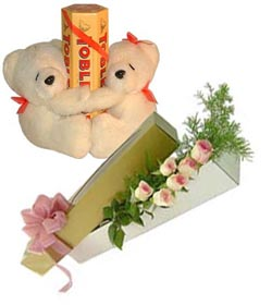 3 Toblerone chocolates 6 pink roses 2 teddies