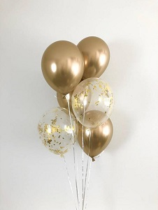 10 Helium Gas filled gold Balloons tied to ribbons