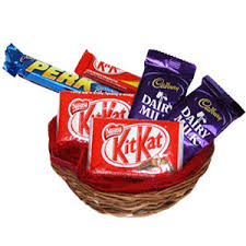 Chocolate basket containing 3 kitkat 2 dairy milk and 2 perk