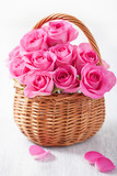 Basket arrangement of 1 dozen pink roses