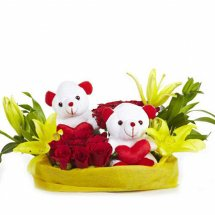 Six Red roses 3 Yellow Lilies 2 Teddies in the same basket