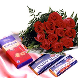 12 Red Roses +Three cadburys chocolates