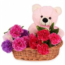 Teddy bear (6 inches ) with 6 pink carnation in same basket