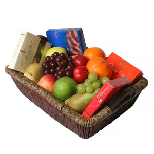 Fruits and Chocolates in a Basket.