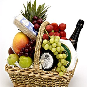Fruits, Chocolates and a Bottle Of Champagne