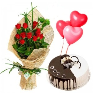 1/2 Kg Chocolate Cake with 3 heart Balloons and 12 Red roses bouquet