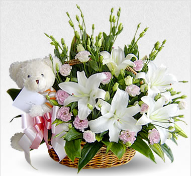 White teddy in basket with White flowers
