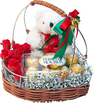 Teddy 16 ferero rocher and 12 red roses all in a basket