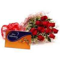 Cadburys celebration box with 8 red roses bouquet