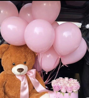 10 Pink gas pre filled balloons tied to the hand of a 12 inched brown Teddy bear with 10 pink roses bouquet