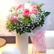 24 Pink and white roses with pink ribbons bouquet
