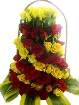 80 Red and Yellow Roses alternately arranged in Basket