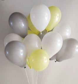 15 Helium Gas filled Silver White and yellow Balloons tied to ribbons
