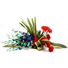 6 Blue Orchids and 6 Red Carnations in a Basket