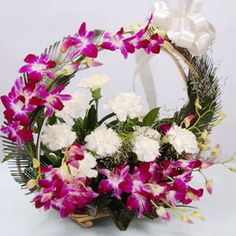 6 Purple Orchids on the handle and 6 White carnations in Basket