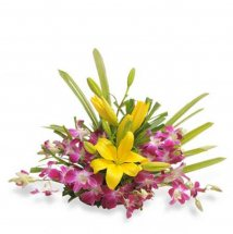 6 Purple orchids and 2 yellow lilies in basket