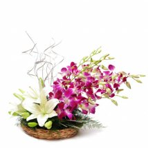 White Lilies purple orchids in a basket