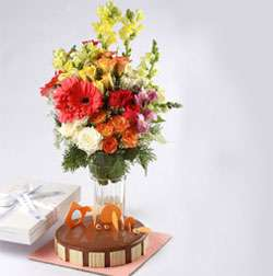 1/2 Kg Hazelnut mousse Cake Eggless from Theobroma and 12 flowers bouquet