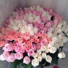 Basket arrangement of 50 white and pink roses