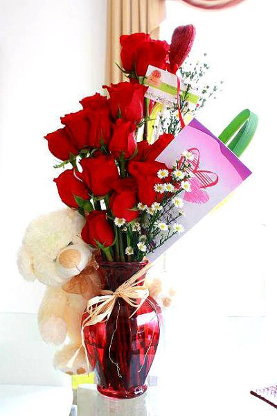 12 Red Roses in Vase with 6 inch Teddy and Card