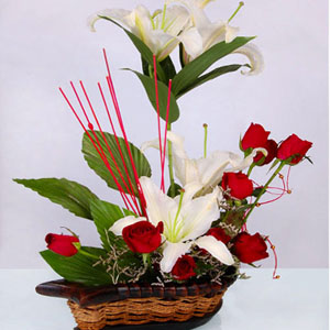 8 red roses with 2 white lilies in basket