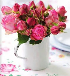 12 pink roses in a coffee mug