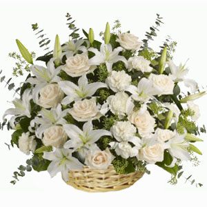 White Liles and White roses in a basket