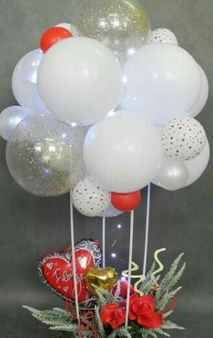 Group of 18 White with one clear and 2 red balloons tied to a basket with red roses and red valentine heart