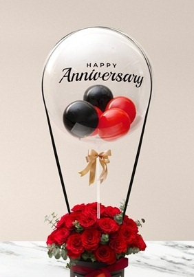 Happy anniversary printed transparent balloon with 4 black and red balloons and 20 red roses arrangement