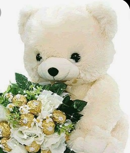 12 inches Teddy bear with 16 ferrero rocher chocolate and 4 white roses bouquet