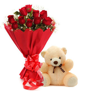 A dozen roses and a cute teddy bear.