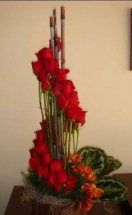 30 Red Roses arranged in 2 step spiral in Basket