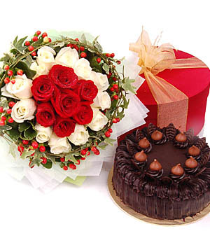 1/2 Kg Cake + 24 red white roses bouquet