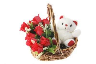 6 red roses arrangement in a basket with a teddy in same basket