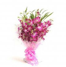 A hand posy of 20 Purple Orchids