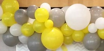 20 Helium Gas filled Silver White and yellow Balloons tied to ribbons